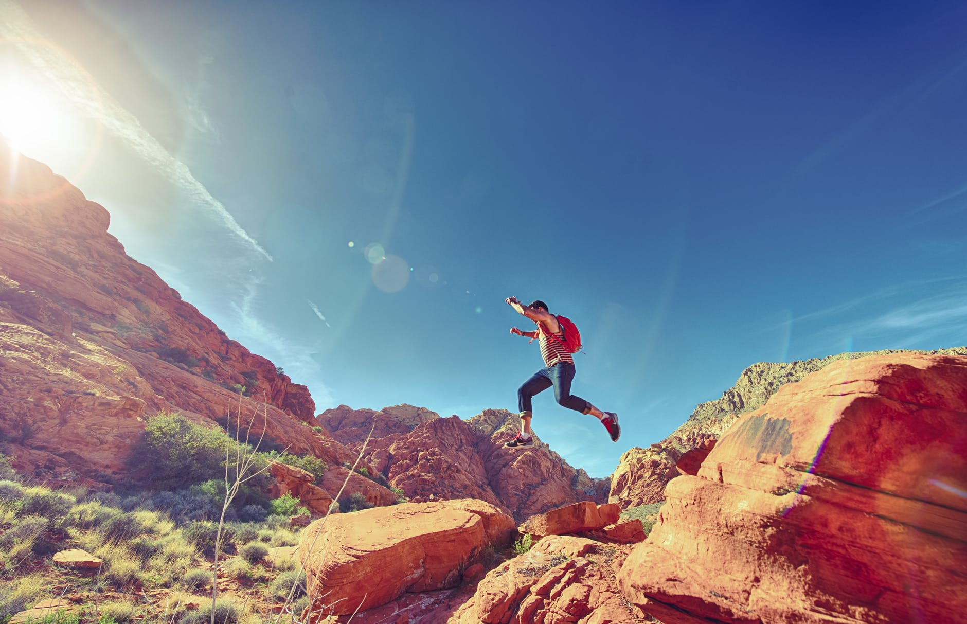 man person jumping desert